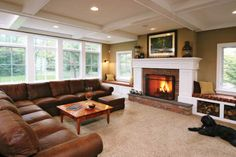I want my living room to look just like this. I love the big fireplace with the window seating on each side! perfect for me :)