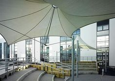 no center pillar, could have 6-8 others around outside, to cover area..membrane-cable tensile structure