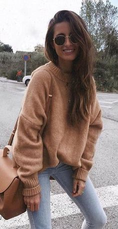 #fall #outfits women's brown sweater and gray denim bottoms with brown leather crossbody bag