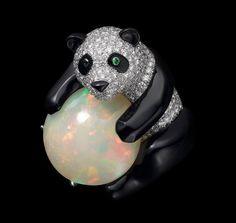 CARTIER. Ring - platinum, one 16.01-carat cabochon-cut opal, tsavorite garnet eyes, onyx, brilliant-cut diamonds. #Cartier #L'OdyséeDeCartierParcoursD'unStyle #2013 #HauteJoaillerie #HighJewellery #FineJewelry #Opal #Tsavorite #Onyx #Diamond