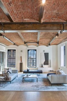 PIN 8: Exposed brick ceiling in this lovely contemporary, industrial living space. They look stunning in the arched shape and really add to the industrial feel of the room, which is quite popular at the moment.