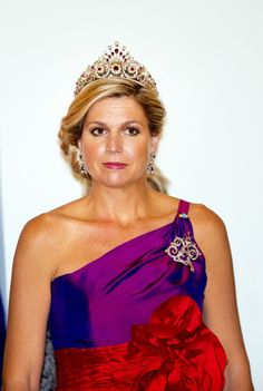 The Dutch Queen Maxima gives Poland a taste of royalty as she wows the Eastern European people in two radiant dresses and glowing jewellery.