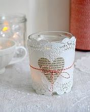 Votive with paper doily and newsprint heart, tied with red twine. Valentine's Day