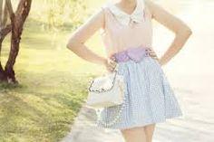 Adoring the belt. Sleeveless button up collared shirt, blue skirt.
