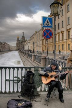 Street artist - part of the Russian life. Griboedov Canal, St Petersburg