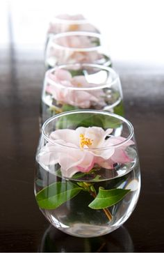 Small, short, and simple votives with flowers are great for decorating the bar, gift table and cake table at your wedding.