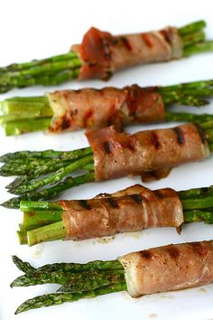 grilled proscuitto-wrapped asparagus...serve with balsamic reduction.  it's super easy.  just reduce balsamic and a little sugar until thick.  but watch it close.  i've ruined more than one pan by walking away mid-way done.