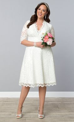 """Planning to say """"I Do"""" soon? Our plus size Wedding Belle Dress is a perfect mix of classic styling with scalloped lace details to provide interest and a bit of drama. The A-line skirt flatters your curves for a delicate look that's wedding-worthy. Find more fashion inspiration at www.kiyonna.com. #kiyonnaplusyou"""