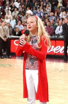T-sizzle a.k.a. Taylor Swift singing the national anthem at age 11. Find the video on YouTube and see how far she has come. #sheisfreakinamazing