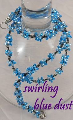 SWIRLING BLUE DUST: $19.99..aqua, silver, light blues with black twine. INTERCHANGEABLE JEWELRY CHAINS that becomes a: lanyard, necklace, choker, belt, or eyeglass chain. Includes gift packs with all connector pieces needed.