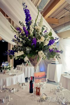 This gorgeous purple, green and white floral centre piece would be perfect for a classy white themed wedding.