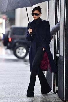 Victoria Beckham wearing Victoria Beckham Half Moon Bag, Victoria Beckham Power Frame Sunglasses and Victoria Beckham Oversized Double Breasted Coat in Navy