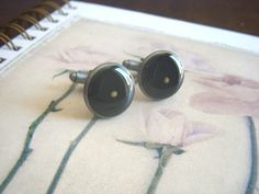 faith as small as a mustard seed - antique silver resin mustard seed cufflinks cuff links. $22.50, via Etsy.