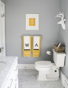 Gray, white and yellow color scheme in this modern family bath