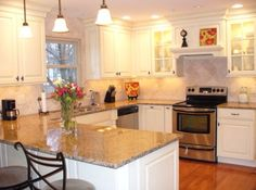 This is the goal for my kitchen.  White kitchen and granite countertops.