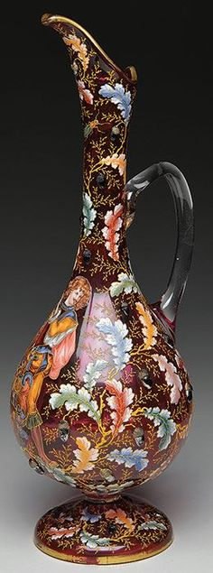 Moser cranberry acorn decorated ewer.