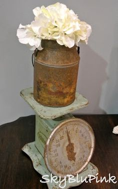 I love using old rusty buckets as vases..loving this old scale too.