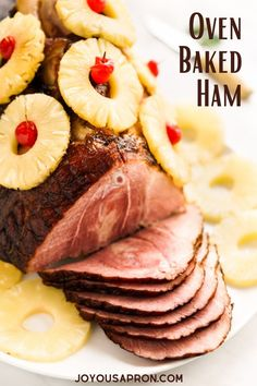 Oven Baked Ham - the lovely main course for Christmas or Thanksgiving holiday dinners. Ham is moist and juicy, coated in a brown sugar and honey glaze, then topped with pineapple rings.