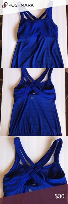 Athleta tank blue w/ bra. *FINAL PRICE DROP* Athleta tank. Size small. Great condition. Tag is starting to come off but tank itself is great condition. Cute gather at bottom Athleta Tops Tank Tops