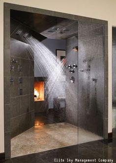 Spacious master bathroom walk through with four shower heads!