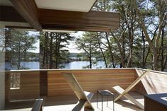 An narrow 18-inch wide ramp leads to a wrapping outdoor deck and open view of the forest. Photograph courtesy of Cape Cod Modern House Trust.