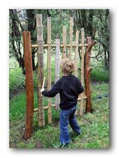 Boy playing with bamboo chimes.  How cool would this be??  Site as other cool ideas.