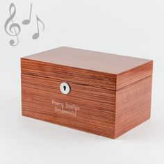 "Bamboo Veneer Musical Jewellery Box - Keep all your special jewellery pieces safe and organized in this beautiful musical jewellery box. It has a gorgeous bamboo veneer finish and off white interior with a large mirror that fills the inside of the lid. Includes a functioning lock with a key with a tassel accent. The song that plays is ""Swan Lake.""  Let our engraving experts add your personalized message to make it one of a kind!"