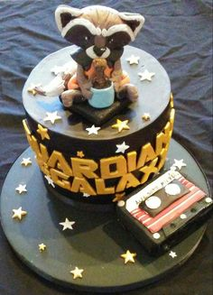 """Guardians of the galaxy cake! Fondant Rocket and baby Groot.  Mini cake cassette tape,"""" awesome mix vol.1"""""""