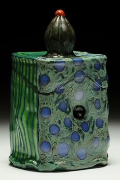 Local artist: Ronan Kyle Peterson; Earthenware, wheel thrown and altered, slips, terra sigillatta, glazes, electric fired to cone 03, 8 x 5 x 5 inches. price 150.00
