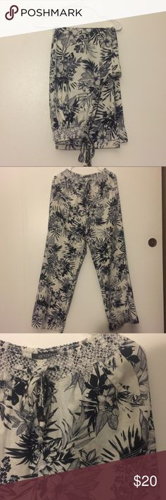 FLORAL PANTS WHITE WAVY PANTS WITH NAVY FLORAL PRINT. THESE FIT LOOSE ON THE LEGS. VERY COMFY. WORN ONCE. Pants Wide Leg