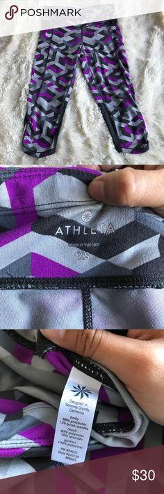 Athleta Geometric Purple Gray Crops Capris Has mesh panels on legs and some thread pulls. See photos for true description. Zipper back pocket. Athleta Pants Capris