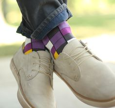 Statement Sockwear checkered pattern featuring purples (like sangria), golden yellow and gray. Shop these purple socks and more.