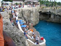 Rick's Cafe in Negril - during the day watch divers make the plunge from 65' up, in the evening catch the sunset and watch the bar morph into a reggae nightclub