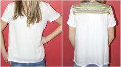 Un haut très simple mais qui sort de l'ordinaire ? C'est le cas du top UU145 de la marque Carminn. Le style est apporté par les détails colorés aux encolures qui se poursuivent jusqu'au haut du dos. Retrouvez ce produit ainsi que de nombreux autres vêtements et accessoires sur http://www.carlaraffi.com