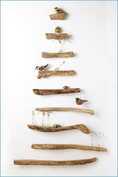 Clever driftwood shelf tree from Anthropologie that lets you display anything (shells, ornaments, pictures...). I think this idea works year round. Featured on Beach Bliss Living:  http://beachblissliving.com/beach-christmas-decorations/