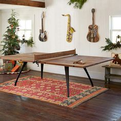 This reclaimed wood and cast iron ping pong table adds a sculptural beauty to any room. Dining Room Design, Dining Table, Gaming Decor, Decor, Ping Pong Table, Table, Shuffleboard Table, Game Room Decor, Dining Room Table