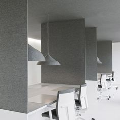 Walls, ceilings, furniture and lighting are covered in grey felt at this advertising office in Amsterdam by Dutch interior architects i29.