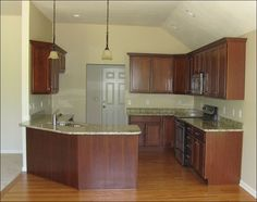 cherry kitchen cabinets with granite | The kitchen's cherry cabinets and granite countertops contrast ...