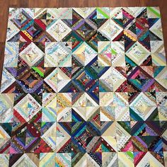 no pattern. I used 7 inch muslin squares to sew my strips onto. Each square is made up of 4 light colored strips, 4 dark colored strips and 8 half light/half dark strips. Random widths. Final quilt top is 9 of these blocks.