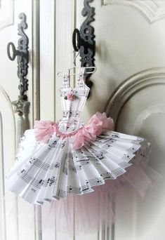 ~Too cute.  music theme baby shower | paper dresses  http://pinterest.com/MyOwnDesign/musical-themed-baby-shower/