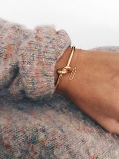 Knot bracelet. Love the sweater too.