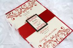 This gorgeous vintage flair invitation in red, brown and creme, features 2 big swirly designs on top and bottom, adorned with crystals and a satin red band with a custom tag.  #wedding #vintage #invitation