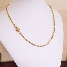 A classically elegant necklace  this 'Vixen's Twist' has been handcrafted with solid 18K Yellow Gold hammered links and 18K Red Gold rings.  The handmade catch is sitting around to the side in this photo and has been handcrafted in 18K Red & Yellow Gold.  #handmadefoxchain #handmadegoldnecklace #handcraftedgoldcatch #uniquegoldnecklace #handforgedbyoneman  #handforgedfoxjewellery #18Kyellowgoldnecklace #18kredgoldnecklace #18krosegoldnecklace #handcraftedgoldcatch