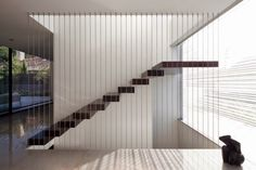 modern staircase design: modern staircase suspended with railing cables