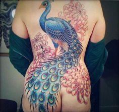 http://www.itattooz.com/itattooz/Birds/Peacock/images/itattooz-large-peacock-tattoo-on-back.jpeg