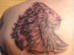 Fun lion tattoo. Blk and gry realism.