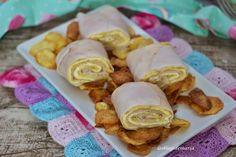 Rollo de tortilla con pechuga de pavo y queso