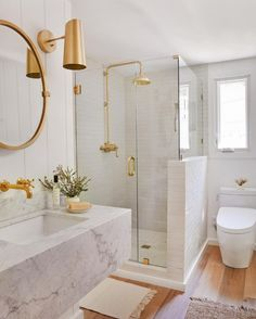 One light, two finishes: our Cypress sconce is a favorite for its Mid-Century inspired design and articulating shade. See it here in two finishes in the same home - which one is your favorite, brass or oil-rubbed bronze? Design by @jennikayne, photo by @tessaneustadt #myonepiece #jklakehouse Bathroom Goals, Bathroom Inspo, Bathroom Inspiration, Modern Bathroom, Small Bathroom, Bathroom Ideas, Bathroom Accesories, Bathrooms Decor, Rental Bathroom