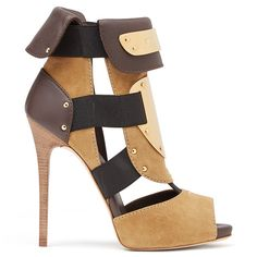An artistic eye is what separates Giuseppe Zanotti from the crowd, and the carefully placed panels of suede, leather and metal on these sandals creates a considered look.