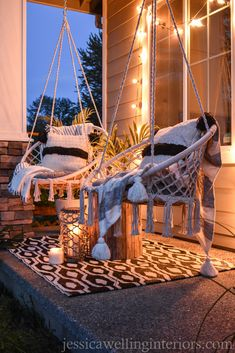 This small front porch gets a Boho Chic makeover on a budget with new macrame swings, a bold outdoor rug, string lights, and loads of tropical Summer ambiance!
